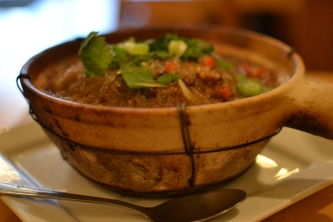 Clay pot dish of cellophane noodles and seafood