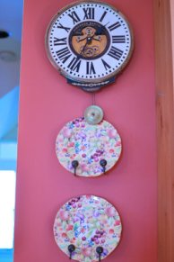 A clock and plates on the wall