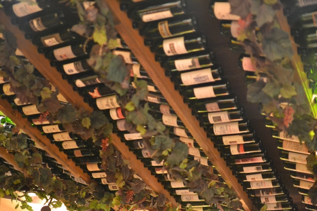 A ceiling of wine bottles at Buca de Beppo Restaurant