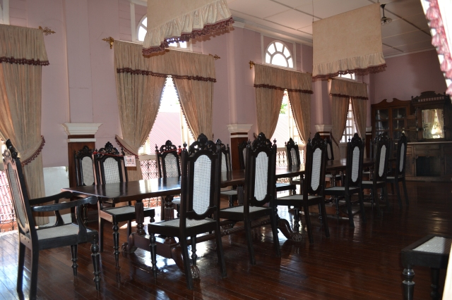 A formal dining room in a house built during the Spanish era