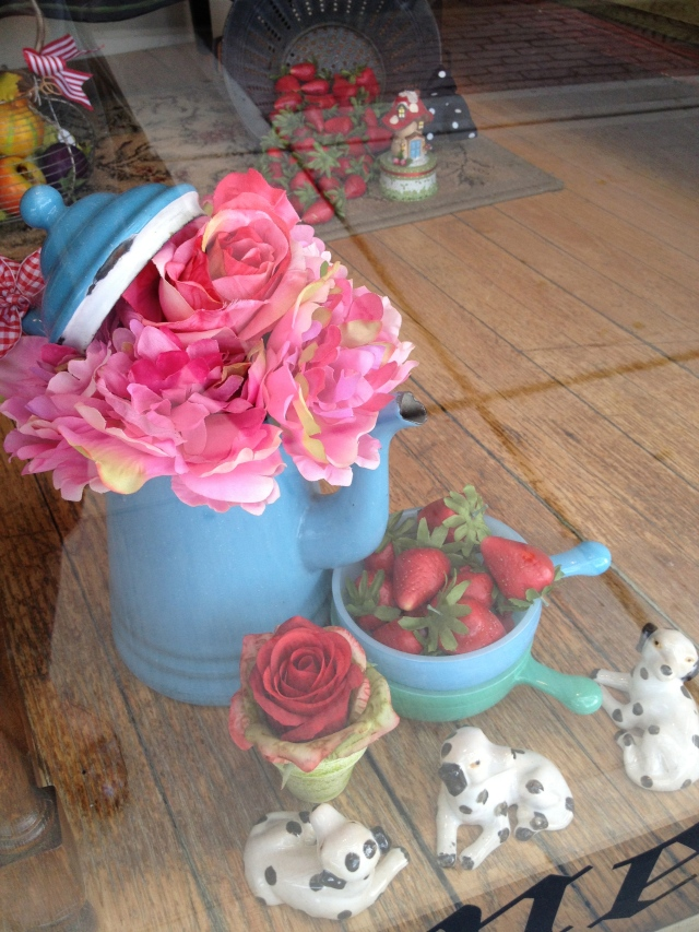 A window display with pink peonies